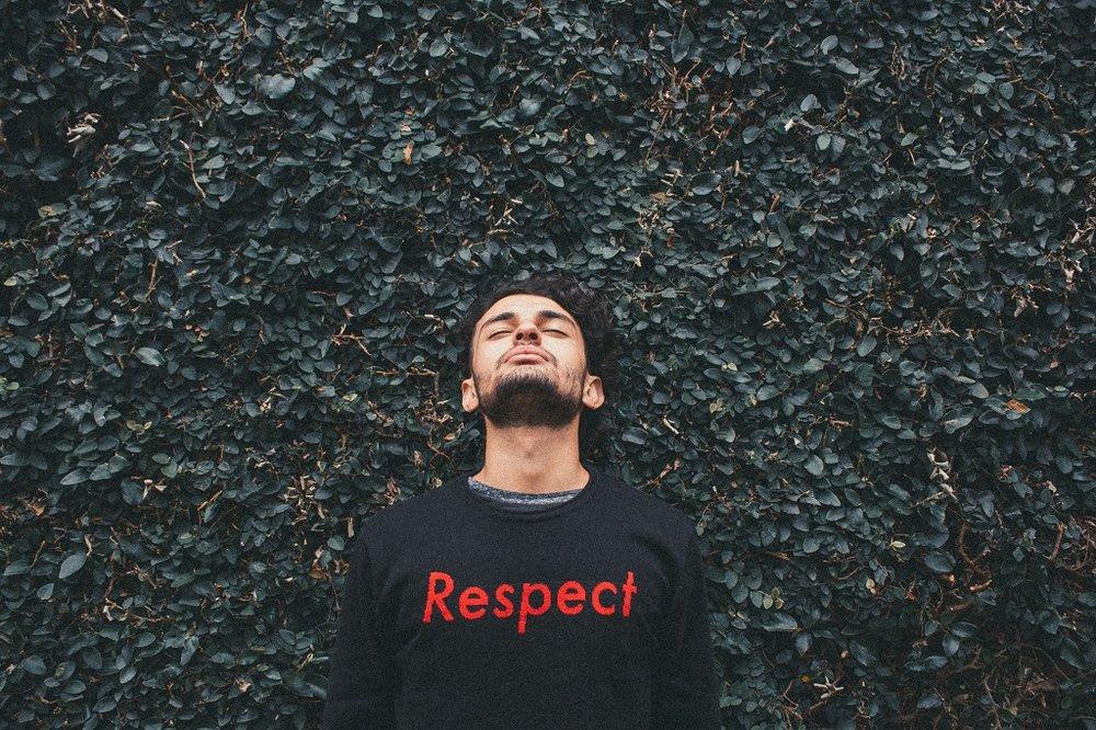 Man wearing respect jumper.jpg