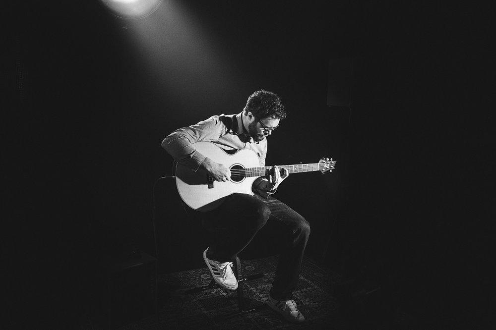 Man playing the guitar.jpg