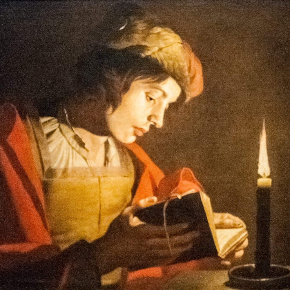 Stom_-_A_Young_Man_Reading_at_Candlelight_reversed.jpg
