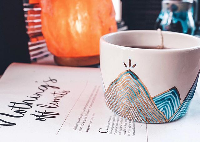"""Thank you to the talented Calgarian @tinavidak for the amazing mountain mug! Making my tea taste better while reading about having your cake and eating it too! The """"Nothing's s off limits"""" approach is a positive mindset when establishing long lasting healthy eating habits. 💭"""