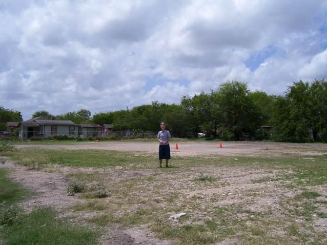 Image of Sister Phylis Peters on land/lot purchased for the construction of today's building (2005).