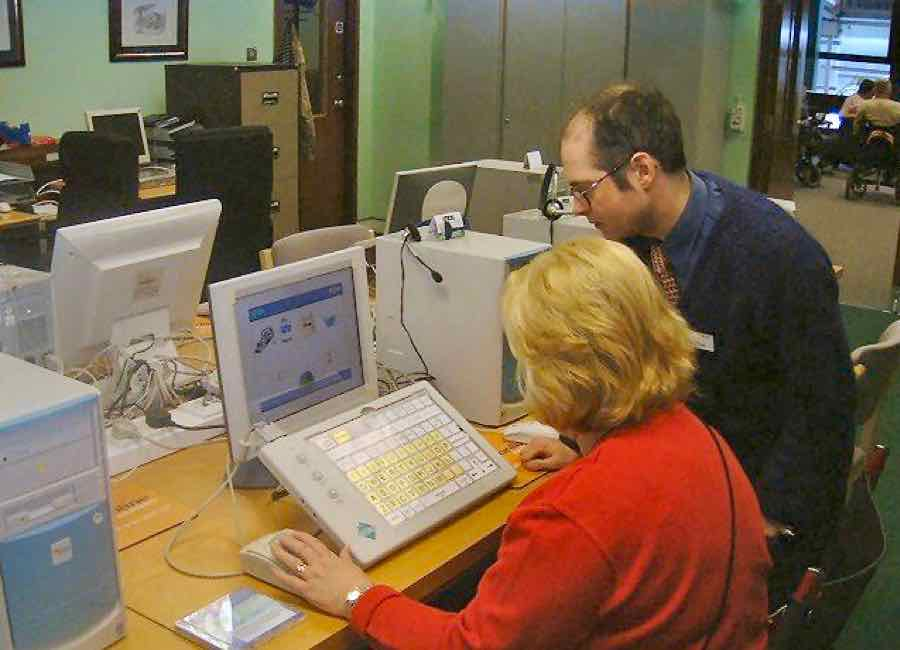 Woman being supported with a specialist computer input
