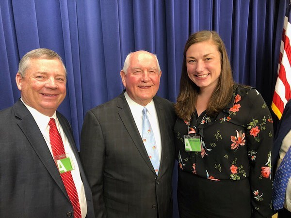 """By signing the farm bill, the president has acknowledged the problems dairy producers face and has put his stamp on improving their circumstances,"" said DFA Board Chairman Randy Mooney. Mooney is pictured (left) with DFA Director of Industry and Community Affairs Stephanie Walsh (right) and Sec. Sonny Perdue (center). #FarmBill Today we give thanks this forward momentum for dairy, but urge @usdagov to prioritize implementation of the new dairy program."