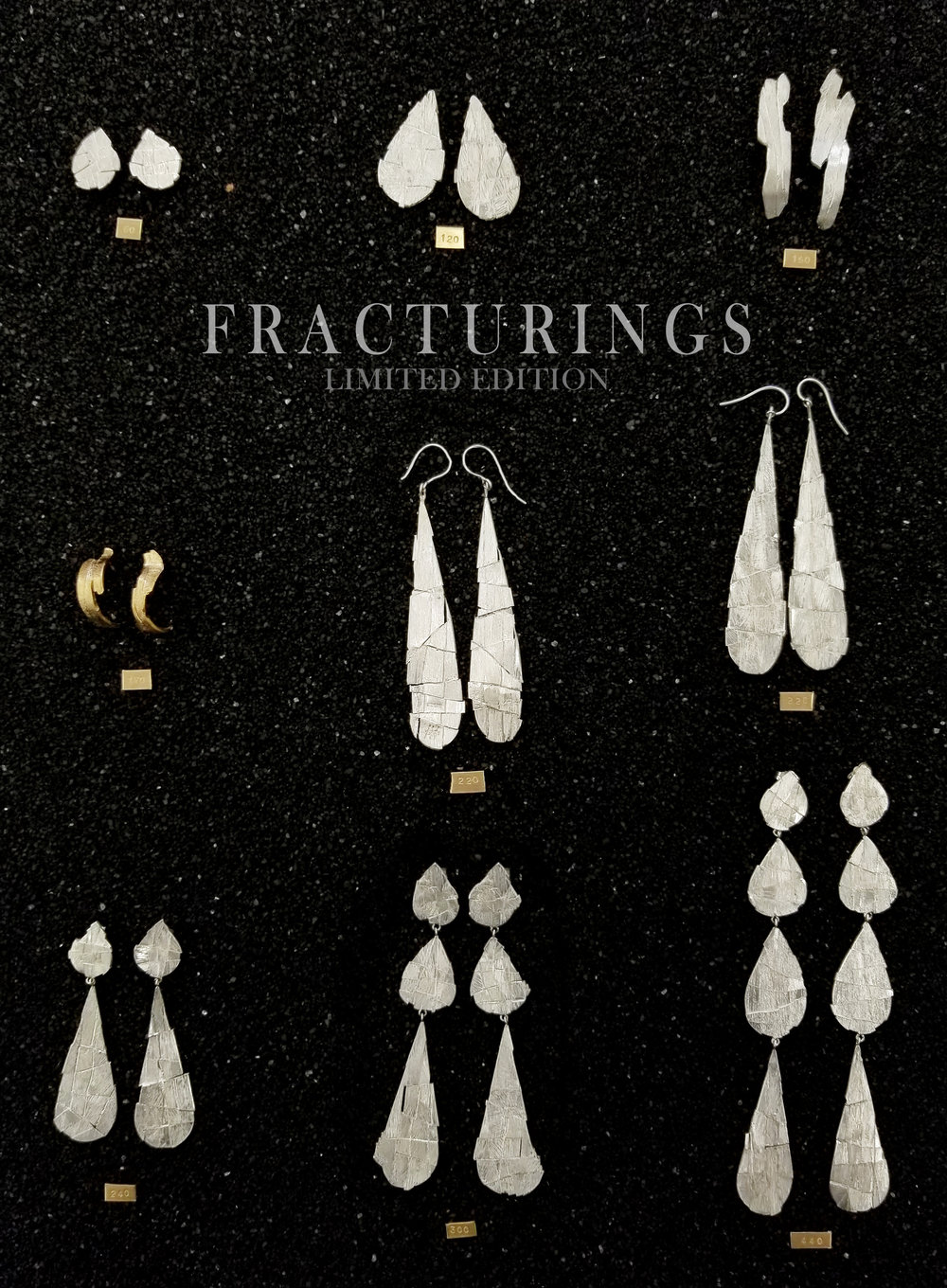 An exploration of texture and reflectivity,  FRACTURINGS  comprises an array of earrings that have been shattered apart and re-unified to reflect light like the facets of stones.