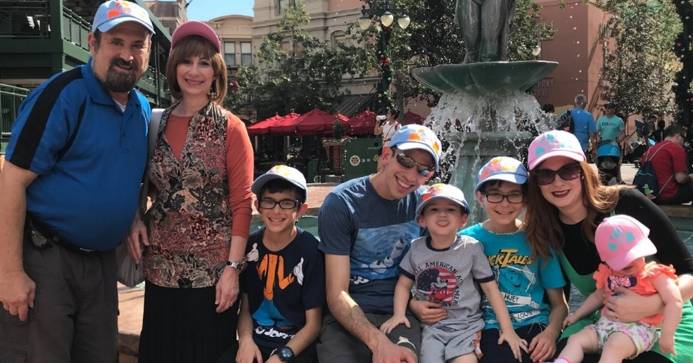 The whole fam in their personalized TYAC Disney hats