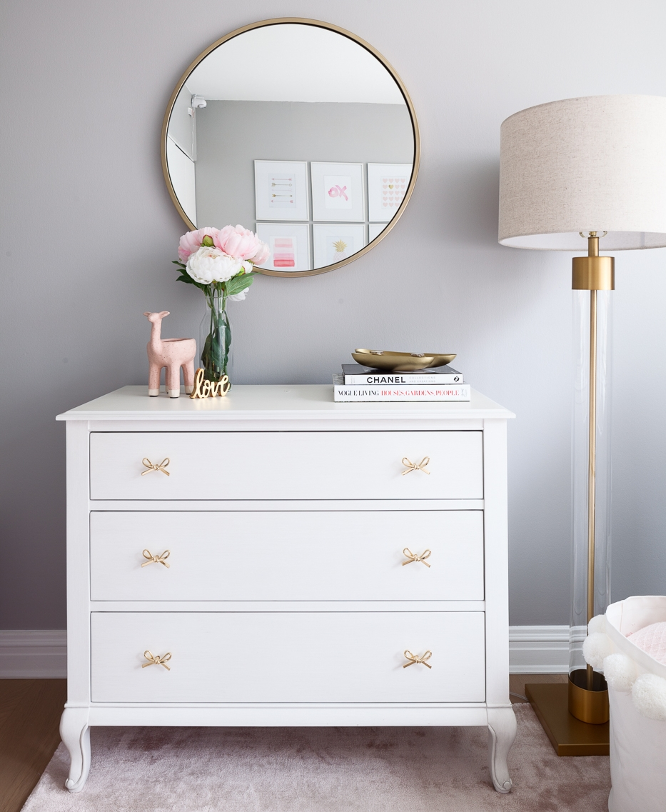 The dresser is a dresser and will grow with our little girl once she is past diapers and onwards to makeup / books / maps. The wood has an aged white finish and will carry the wear and tear of growing up beautifully.