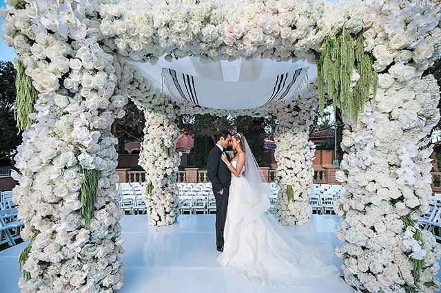 A quiet moment alone under their dreamy chuppah (Venue: @fairmontgranddelmar | Planning/Design: @internationaleventco @margot_iec | Florals: @marksgarden @michael_MarksGarden | Lighting: @thelightersidela | DJ Band: @liventgroup | Photographer: @jessicaclaire | Videographer: @davidmedillproductions | Rentals: @palacepartyrental | Cake: @jandlcakes)