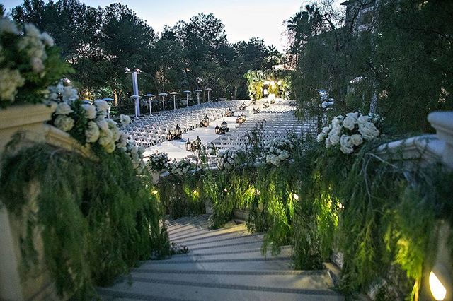 A pepper tree embellished staircase to lead our bride down her aisle (Venue: @Monarchbresort | Planning/Design: @internationaleventco @margot_iec | Florals: @marksgarden @michael_MarksGarden | Photographer: @jessicaclaire | Videographer: @whiteroseproduction | Band/Lighting: @LIVentgroup | Rentals/Decor: @harryspartyrental | Linens: @latavolalinen | Ice Carving: @icewiz7 | Trees: @jackson_shrub | Wedding Cake: @jandlcakes | Sushi Station: @redfishkitchen | Fruit Station: #violetevent | Make Up: @outofcontrol_nicole @flawlessfacesinc | Hair: @tigerbahmb @paristouhairstudio)