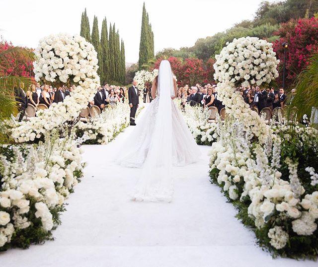 Our beautiful bride @jennifer_chaplin_tolkin as she starts her walk down the bridal aisle (Ceremony Venue: Private Residence | Reception Venue: @bevhillshotel | Planning & Design: @internationaleventco @margot_iec @leeschrager | Floral Design: @marksgarden | Photo: @walker.studios | Video: @hoo_films | Décor/Furniture: @revelryeventdesign @matiasdoorn | Lighting: @images_lighting | Rentals: @tacer_losangeles | Caterer: @wpcatering | Music: @westcoastmusicbevhills | Specialty Performer: @jlo | Sound: @design.sound | Linens: @latavolalinen | Invitation Design & Printed Material: @cecinewyork)