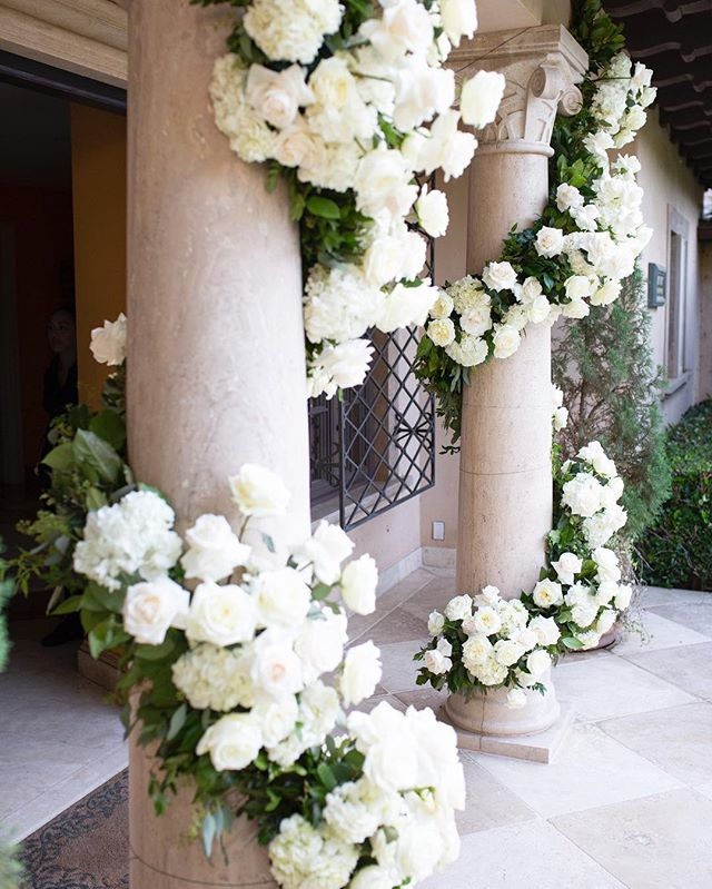 Floral vines by @marksgarden were wrapped around the existing columns to welcome guests into the ceremony site (Ceremony Venue: Private Residence | Reception Venue: @bevhillshotel | Planning & Design: @internationaleventco @margot_iec @leeschrager | Floral Design: @marksgarden | Photo: @walker.studios | Video: @hoo_films | Décor/Furniture: @revelryeventdesign @matiasdoorn | Lighting: @images_lighting | Rentals: @tacer_losangeles | Caterer: @wpcatering | Music: @westcoastmusicbevhills | Specialty Performer: @jlo | Sound: @design.sound | Linens: @latavolalinen | Invitation Design & Printed Material: @cecinewyork)