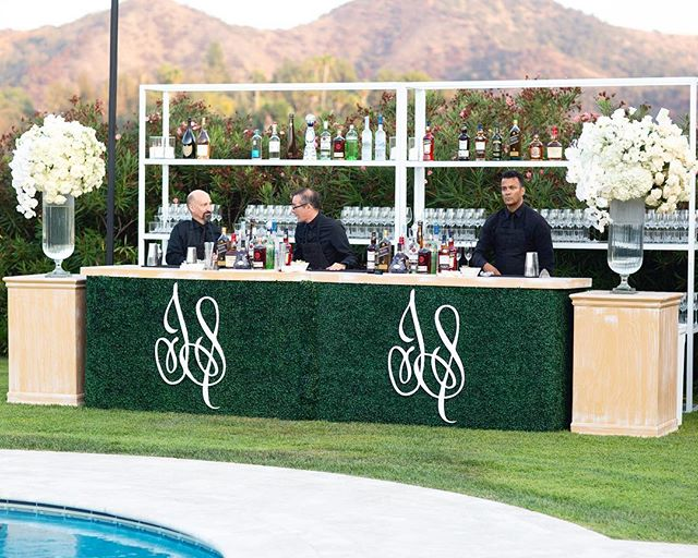 Personalized hedge bars from @revelryeventdesign for #takenbytolkin (Ceremony Venue: Private Residence | Reception Venue: @bevhillshotel | Planning & Design: @internationaleventco @margot_iec @leeschrager | Floral Design: @marksgarden | Photo: @walker.studios | Video: @hoo_films | Décor/Furniture: @revelryeventdesign @matiasdoorn | Lighting: @images_lighting | Rentals: @tacer_losangeles | Caterer: @wpcatering | Music: @westcoastmusicbevhills | Specialty Performer: @jlo | Sound: @design.sound | Linens: @latavolalinen | Invitation Design & Printed Material: @cecinewyork)