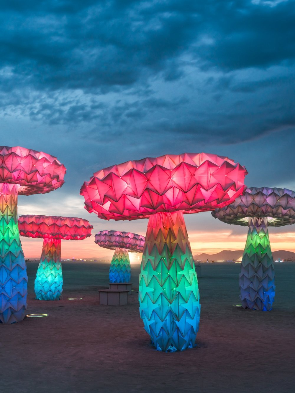 Shrumen Lumen   (2016) Five large-scale Origami mushrooms that morph into different shapes when activated by visitors. Currently at at The Smithsonian's Renwick Gallery in Washington, D.C. for the exhibit  No Spectators: The Art of Burning Man.    Photograph by Rene Smith   [ See more ]