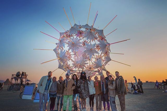 Last Friday, we collaborated with @art_haus_burn on a sunrise performance. . Some of the team gathered afterward for a photo—much more glam than our scrubby build ones! . Grateful to our friends at @art_haus_burn for the gift of their time and beautiful music, and for the excuse to come together! . #burningman2018 #arthaus #radialumia
