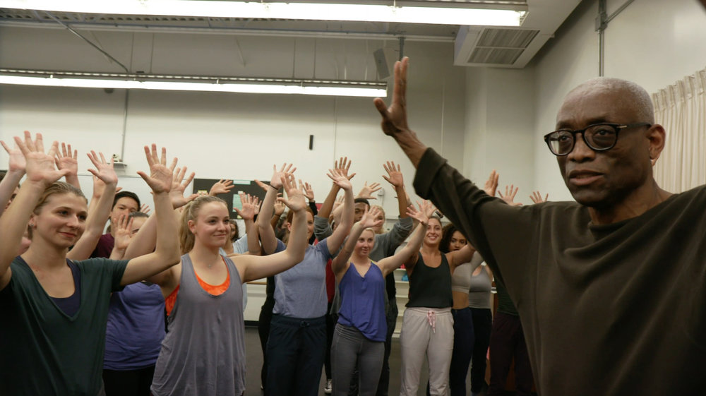 Bill and students with hands in air.jpg