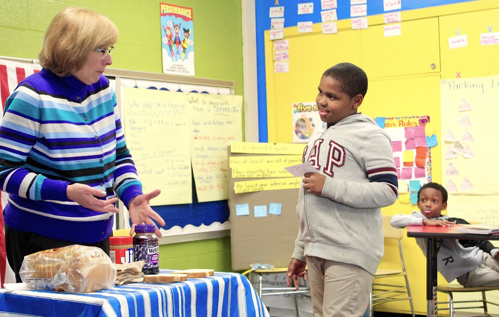 Avery Marshall, a third grader at Moravia Park Elementary School, gives his teacher Jeannine Disviscour instructions for making a sandwich.