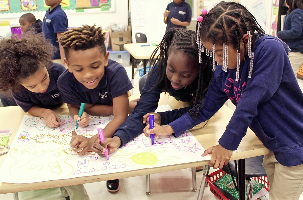 Students from the CTY Baltimore Emerging Scholars Program at Henderson Hopkins Elementary School brainstorm ideas for a new playground.