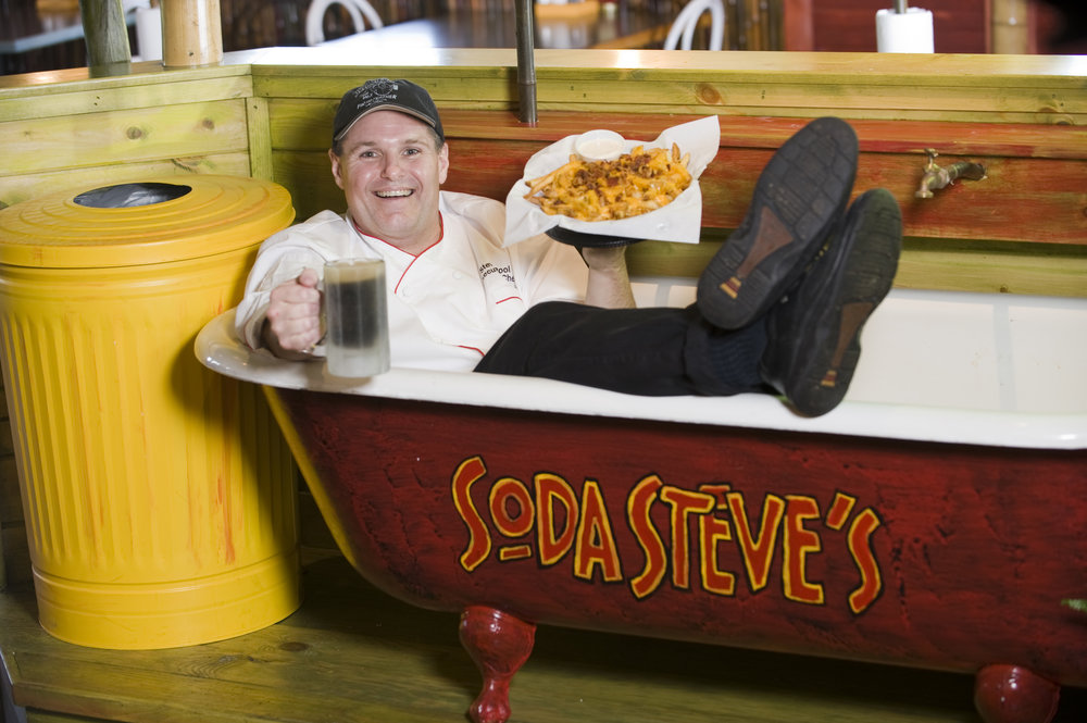 Steve in tub w rbeer and chz fries.jpg