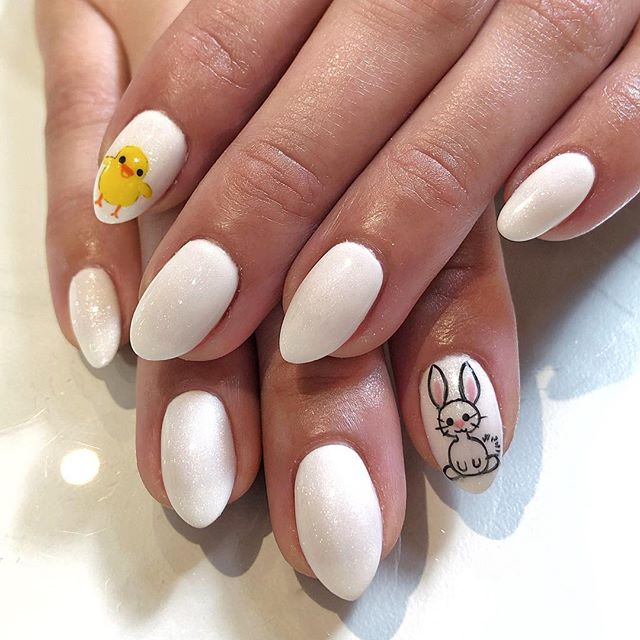 Easter themed nails don't have to be only bunnies and baby chicks but..isn't it just too cute?!?! . . . #handpaintednailart #handpaintednails #costamesa #oldtowneorange #thecampoc #chapman #easternails #easternailart #bunnynails #babychicknails #easter #organicnails #naturalnailsalon