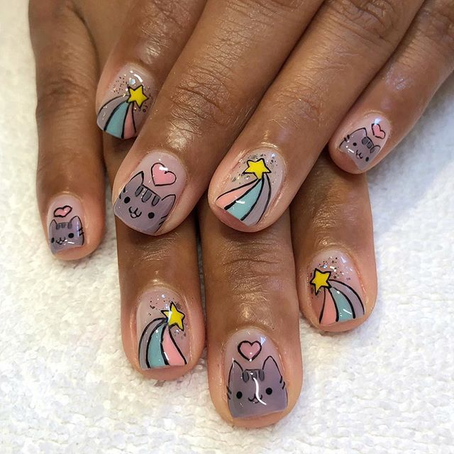 Pusheen cat on your nails? WHY NOT?! 😍 These little pieces of art were done by @omsphoenix and cannot be done by all our manicurists unfortunately, please let us know if you'd like any detailed art by sending us a DM or calling ahead!⭐️🌈⭐️ . . . . #lollipopnailstudio #lollipopnailstudioorange #thecampoc #pusheenbox #pusheen #pusheennails #catnails #cartoonnails #handpainted #handpaintednailart #rainbownails #shootingstarnails