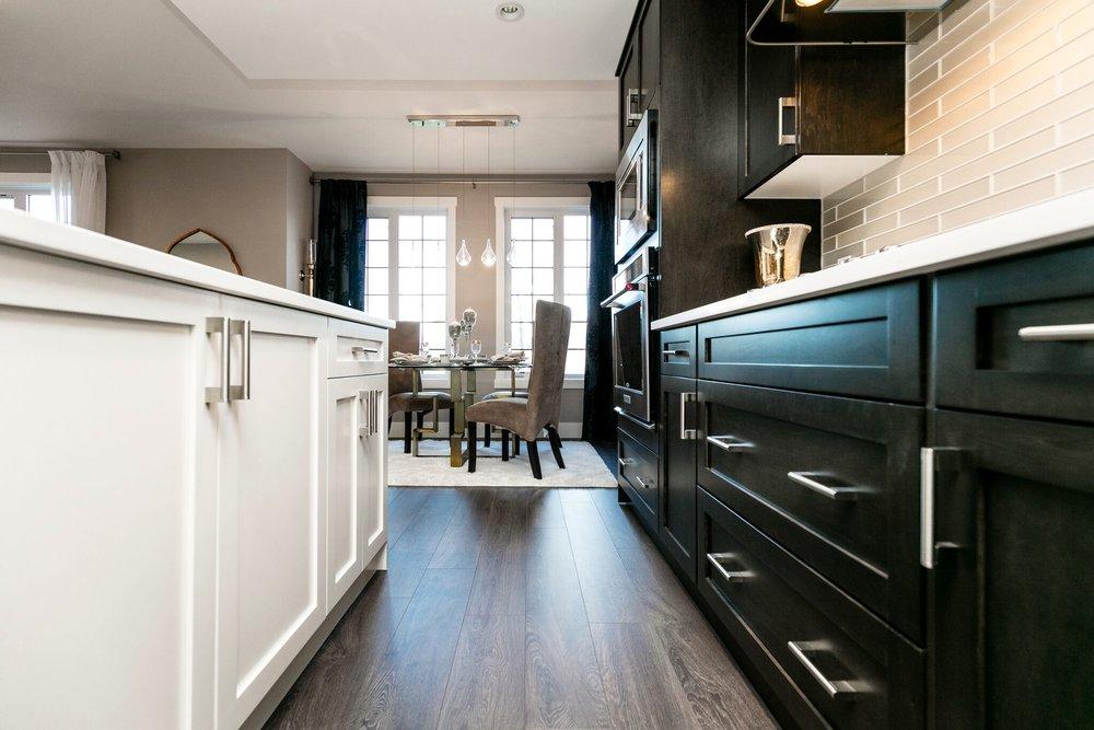 We dress to impress. - Hardwood floorsBosch appliancesMaple CabinetryIn suite stainless steel washer/dryerQuartz CountersGlass tile backsplash