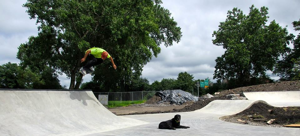 Billy skates the Buffalo, New York Skate Plaza while Jake lounges on the concrete