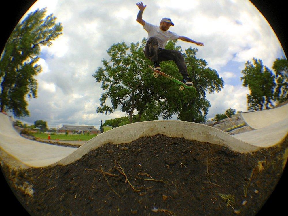 Justin ollies the bump at the Buffalo, New York Skate Plaza