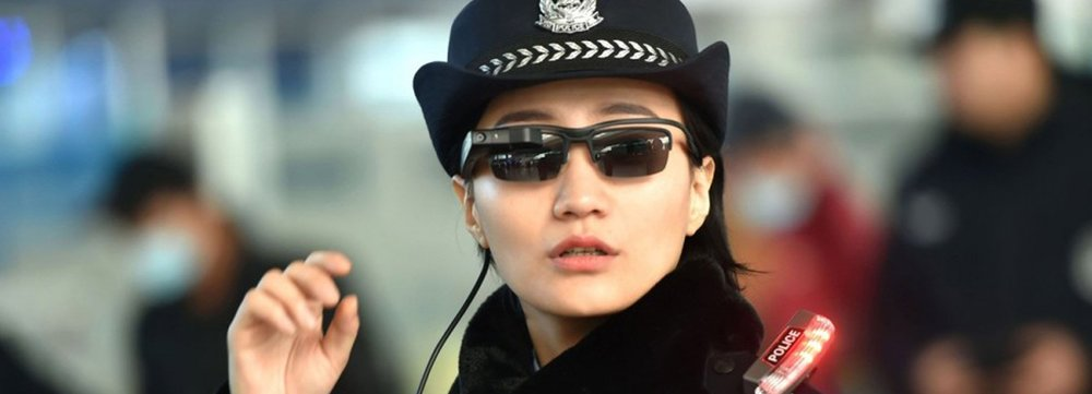 chinese-police-facial-recognition-glasses-designboom-1800.jpg