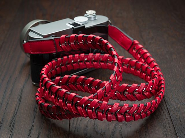 The Vi Vante Ascari Rosso Leto Napa Leather Camera Strap with beautiful gun metal electroplated grommets and mounting rings. 47inches long / 119cm International shipping options available.