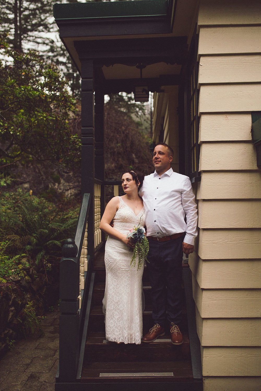 Lexi and Matt standing on the steps at Minnekhada Lodge in Coquitlam