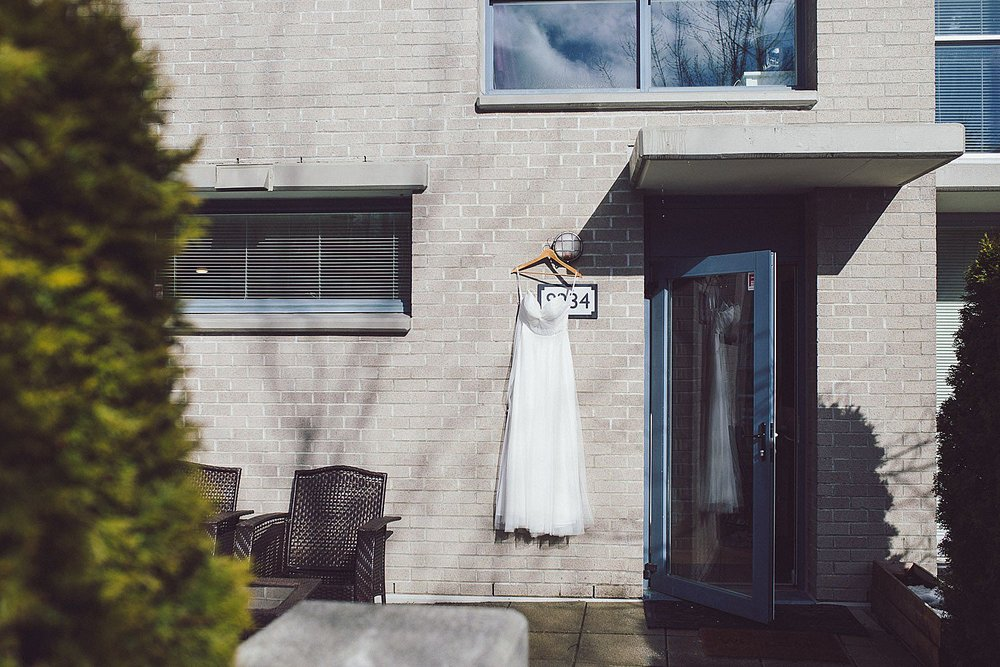 Wedding dress hanging outside of bride's house