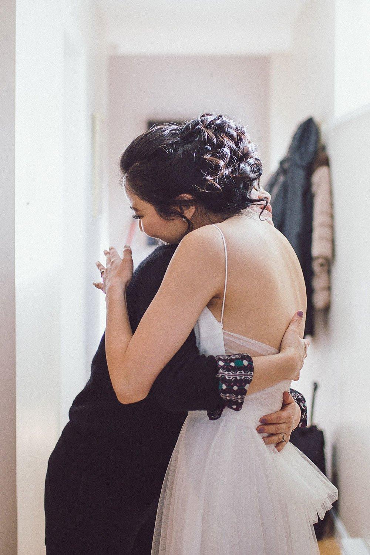 Bride giving her mom a hug
