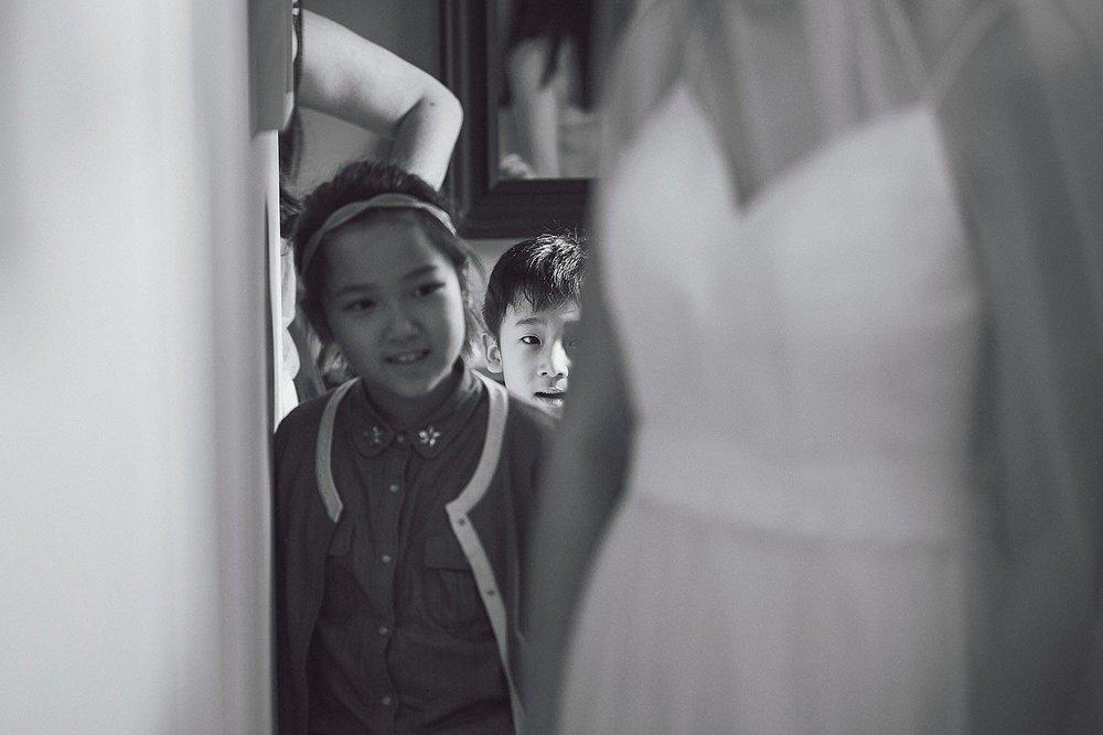 Nephew sneaks a peak at the bride