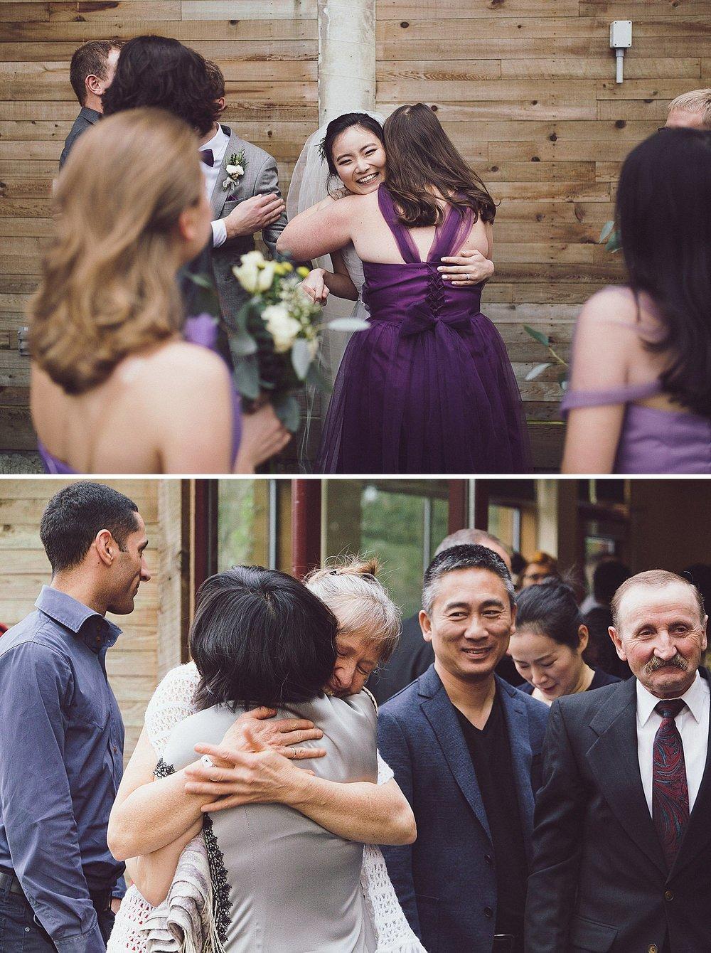Everyone giving congratulatory hugs to the bride and groom
