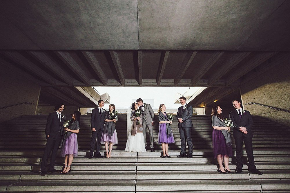 Wedding Party Portraits on the staircase by the bus loop