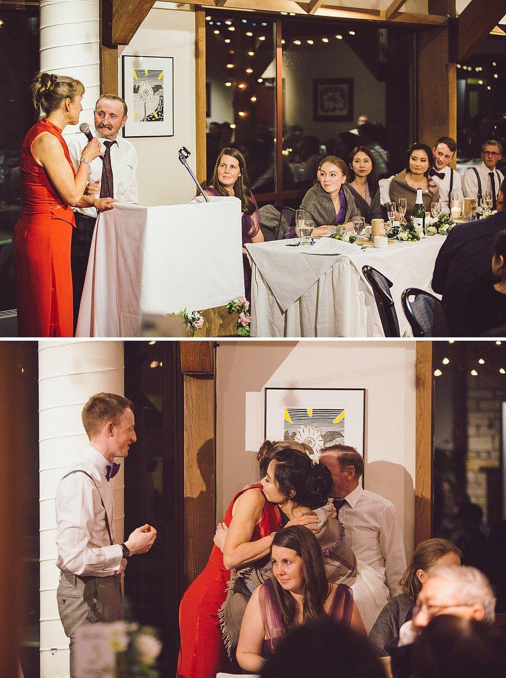 Groom's parents speak at the wedding reception