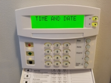The keypad will then enter the menu, starting at Time and Date. Press the down arrow to scroll to User Codes.
