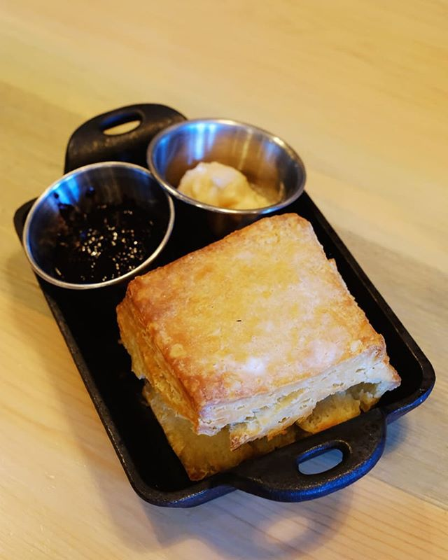 Freshly baked house made biscuits with sea salted honey butter and La Luna jam.