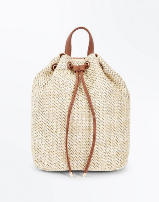 12.Tan Straw Drawstring Backpack - Day Tripping or Festival - £19.99 (Image New Look)