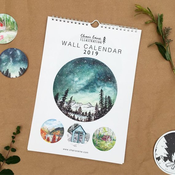 2019 WALL CALENDAR - Charis lovingly designs, paints and creates most of her products from her home studio in York, UK. Recently rebranded from Studio Factotum, after many customers told Charis they didn't realise she was the artist behind the products! After finding herself doomed to rubbish hospitality jobs after leaving uni, she decided to start painting again, creating one small artwork a day. What originally began as a way for me to find my creativity again, blossomed into Charis Raine Illustration with help from the Princes Trust. She officially launched in September 2016.This stunning wall calendar features 13 pages of original colourful gouache and watercolour paintings. Each page is designed so that you can cut out the illustrations for a set of mini prints after use.