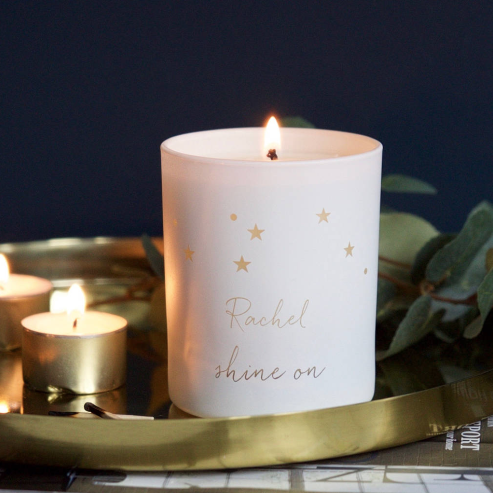 PERSONALISED CONSTELLATION SCENTED CANDLE - Illumer is a unique candle brand that holds emotion and empathy at its core. All Illumer candles are beautifully scented and hand poured in the UK, using recycled glass and cotton wicks. Every candle is made from vegan friendly 100% plant based wax infused with fine fragrance. Each candle will be bespoke etched at their studios in Surrey and will be sent to you in a branded drawstring pouch.See your stars and words softly illuminated by candlelight when lit, making a lovely birthday gift for those you love. Elegant, personalised candle lids are also available and may be etched with your chosen words. All Illumer candles make lovely keepsakes too. Once your candle has burnt down you can simply place a tea light or flowers in the glass jar and continue to enjoy your chosen constellation.