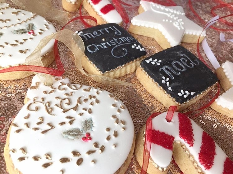 HANDMADE CHRISTMAS COOKIES - Kerry Ann's Cake Boutique is a gorgeous boutique kitchen based in Essex. Kerry began the business thanks to her Nan and Mum and early memories of cooking and baking, helping Nan make a pie for the family and having her very own piece of pastry to roll out, were very fond memories. Sunday was her favourite day of the week as it was Mum's baking day and she would so look forward to the afternoon when they were allowed to finally tuck into the array of tea time treats they had so lovingly made. It wasn't until more recent times that Kerry found enthusiasm for all things sweet merged with a new found creative streak, and she began designing & making cupcakes and birthday cakes for friends and family. With the support and encouragement of her nearest and dearest, her hobby began to grow into a small business. Kerry started to perfect her sugar craft skills which launched her into the wedding industry. She now loves creating lots of edible memories for lots of lovely people.These handmade Christmas Cookies are beautifully made and delicious too, and would make the perfect gift for anyone with a sweet tooth this Christmas.