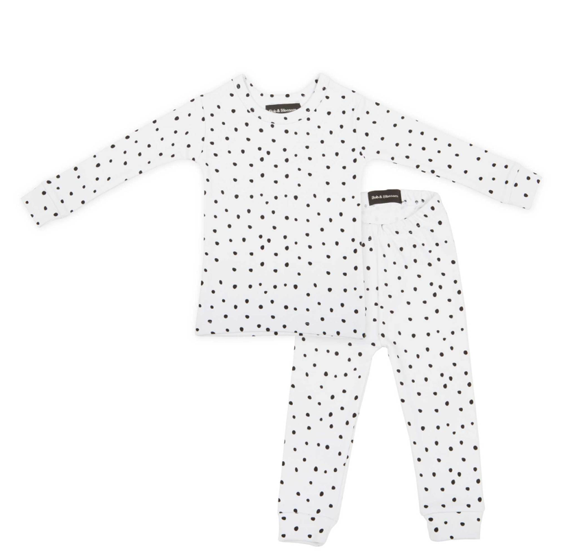 WHITE + BLACK SPOT PRINT PYJAMA - Kirsten, founded Bob & Blossom in 2000, following the birth of her baby boy Manny (middle name Bob). She started the brand by creating a range of Baby T shirts that she could gift to friends, who had also had new babies and not only were they a hit with her friends, local stores also wanted to stock them. Since then Bob & Blossom has grown to include a super soft cotton babywear range, sweatshirts galore, our ever popular Birthday T shirt collection and a selection of full on fabulous, frilly tutus. They are now stocked in many beautiful boutiques across the world, as well as their own little shop in East London's Columbia Road, home to the famous Sunday flower market. (Which is a beautiful store, I've been lucky enough to visit on a few occasions!)These Super soft cotton, slim fit pyjamas are perfect for little sleepy + not so sleepy heads!