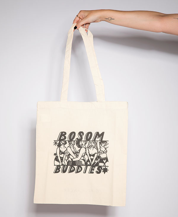 BOSOM BUDDIES TOTE BAG - Get involved in the GirlVsCancer movement and help raise funds for some incredible cancer charities. This fab cotton Bosom Buddies Tote Bag was designed in London by Poppy's Papercuts for GirlVsCancer and 25% of each sale will be split equally between Coppafeel, Future Dreams, Trekstock and Look Good Feel Better.Lauren Mahon started the GirlVsCancer movement when she was diagnosed with an an aggressive cancerous lump in her breast, in 2016. Fed up of the perception that cancer is a disease for the over fifties Lauren decided to grab her breast cancer diagnosis by the boobs and began sharing the nuances of her cancer beating crusade on her blog and instagram sharing tales of her treatment in an authentic and accessible way in an attempt to tackle the cancer taboo and create a better understanding of the challenges facing those diagnosed with cancer in their 20's + 30's. Be sure to check her out for some seriously cool t shirts and accessories that will not only make great gifts for Christmas, but make a difference in the process.