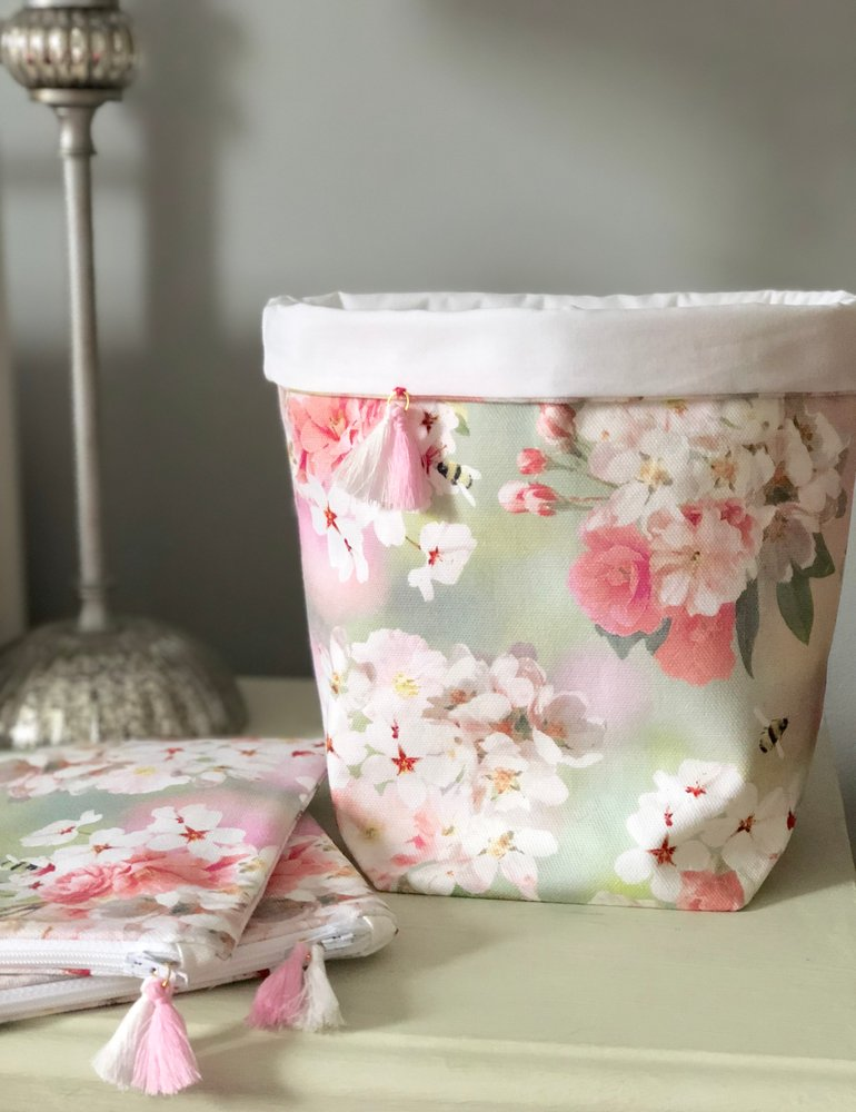 BLOSSOM BEE FABRIC BASKET - The floral world of Peonie Cole is a fresh and floral home and lifestyle brand created by textile designer Catherine Cole. Catherine's love of flowers and nature inspires her everyday to create timeless designs for gifts, and the home that celebrate the colour and beauty of British nature. After growing up and spending many years in Scotland, Catherine is now enjoying exploring her new home in Harrogate, North Yorkshire. (Be sure to check out Catherine's Instagram feed its beautiful!)This beautiful handmade fabric basket is the perfect addition to any bedroom, studio or desk area. Featuring a delicate tassel and each basket is handmade by Catherine using lovely cotton half panama fabric which has been printed using eco-friendly inks in Britain.
