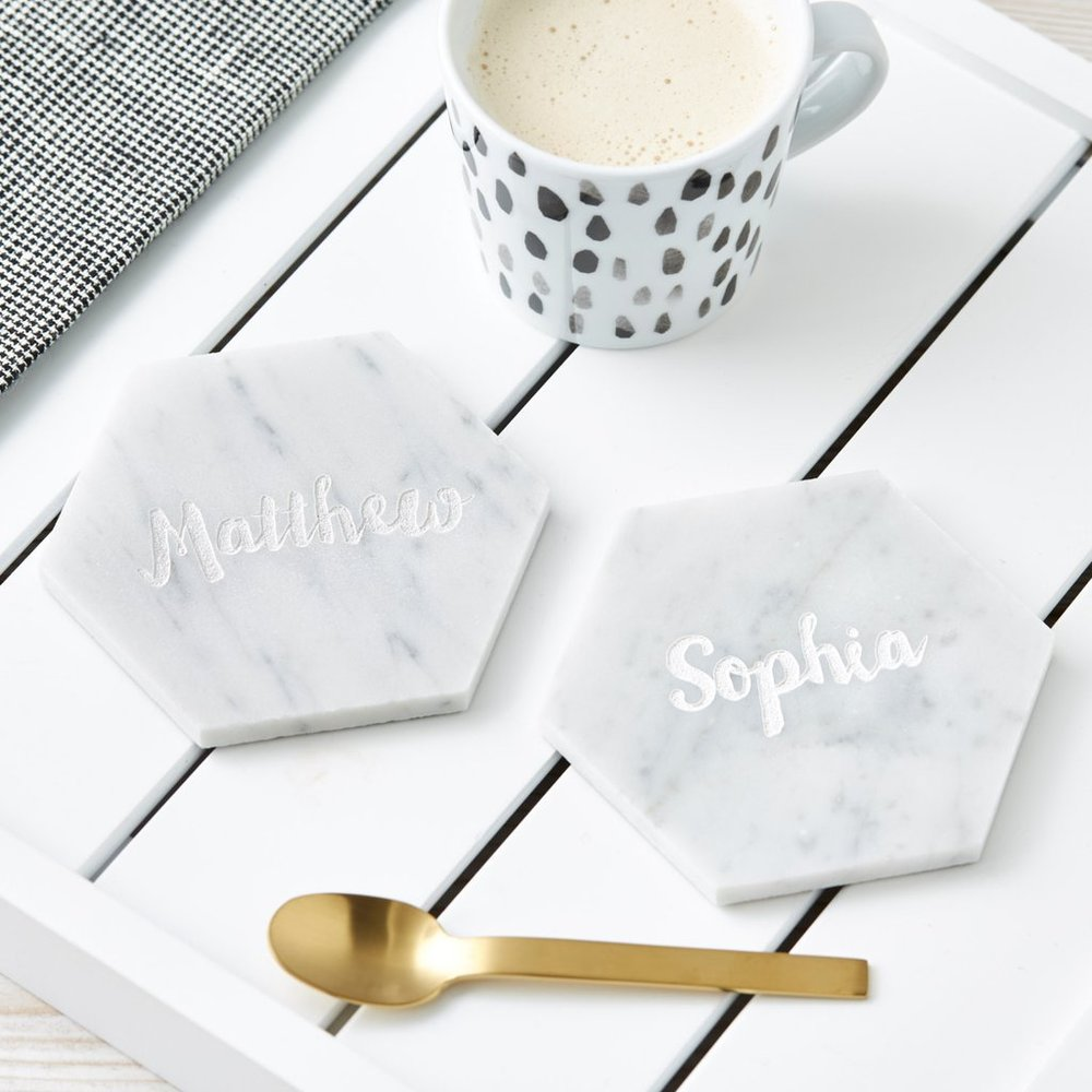 PERSONALISED HEXAGONAL MARBLE COASTER - Memories of childhood holidays, lazy summers and cosy winters by the fire or playing in the snow are all a rich source of ideas, woven with the creativity that is Sophia Victoria Joy. The story of Sophia Victoria Joy began in 2010. Set up by Sophia (her middle names are Victoria and Joy) the family business runs from her Hampshire-based studio here in the UK. She now has a specially selected team of people working behind the scenes to ensure that every product produced is just as special as the original concept she once dreamed up over a cup of tea.These stunning, high quality personalised hexagonal marble coasters are a brilliant finishing touch to any coffee table. A lovely addition to any home. These coasters can be beautifully engraved with any name or phrase of your choice.