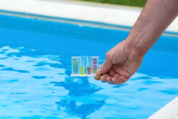 A Swimming Pool Expert Testing Pool Water