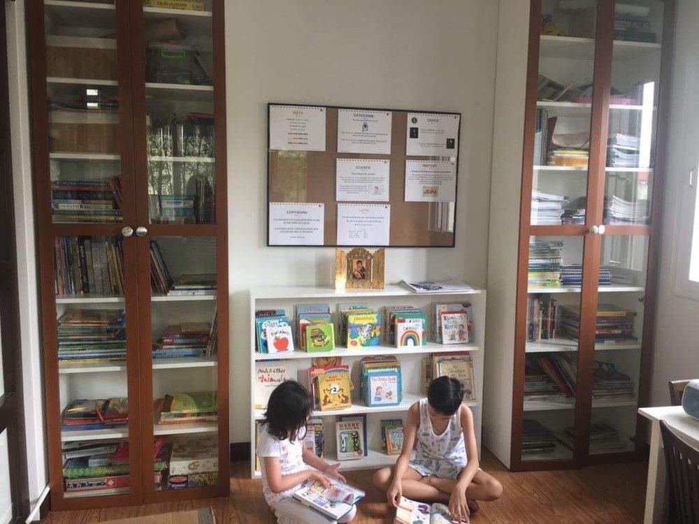 Siblings Aniya (6)and Ilai (8), reading their good books.