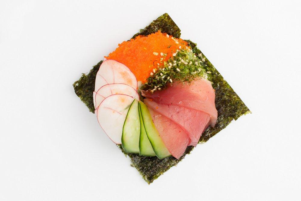 Cali Sushi Donut   Ahi Tuna, Sushi Rice, Wasabi Lime Guacamole, Cucumber, Red Radish, Masago, Toasted Sesame $7.95