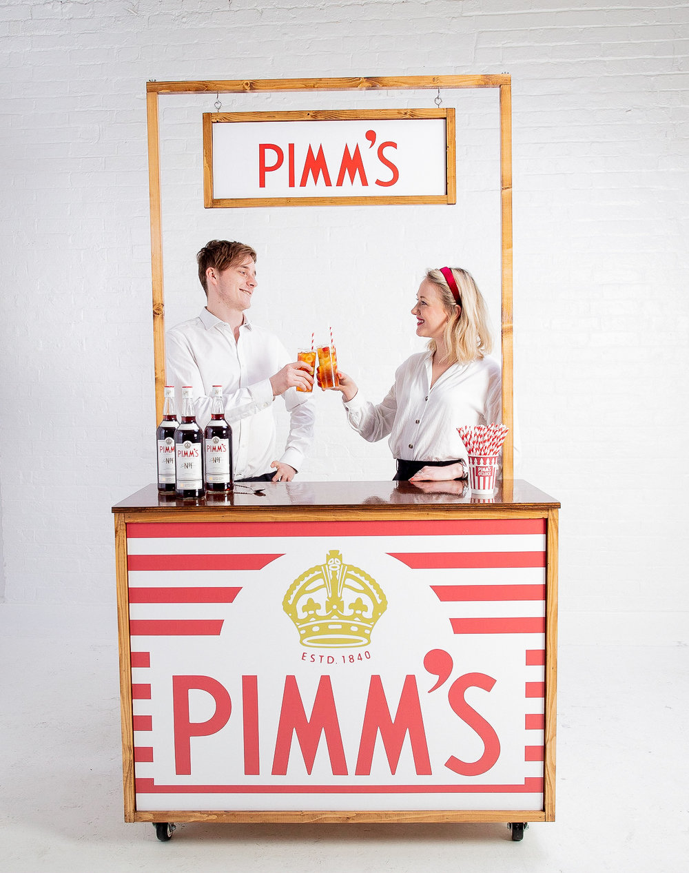 Quirky Group Pimms fully branded cocktail bar with bartenders