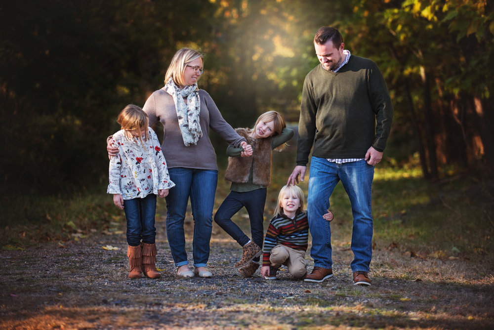 a photo of a family in the fall